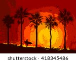 silhouettes of palm trees and a ...