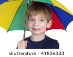 Smiling kid with an umbrella - stock photo