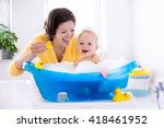 happy baby taking a bath... | Shutterstock . vector #418461952