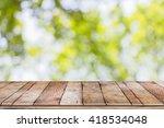 empty wooden table with garden... | Shutterstock . vector #418534048