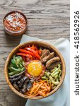 bowl of bibimbap on the wooden... | Shutterstock . vector #418562926