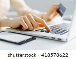 woman holding credit card in... | Shutterstock . vector #418578622