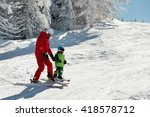 skiing instructor and a little... | Shutterstock . vector #418578712