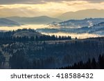 cold morning fog with yellow hot sunrise in the mountains - stock photo
