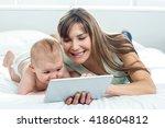 happy woman showing digital... | Shutterstock . vector #418604812