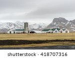 Small photo of Farm house with the farming equipments, silo, packed haybale with the mist over mountain view in a misty day