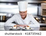 happy female chef looking at... | Shutterstock . vector #418735462
