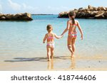 two sisters holding hands and... | Shutterstock . vector #418744606