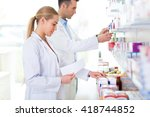 female and male pharmacists in... | Shutterstock . vector #418744852