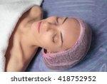 girl in spa salon is laing on... | Shutterstock . vector #418752952