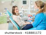 young woman dentist showing... | Shutterstock . vector #418881172