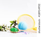 Small photo of Spa salt, wisp, towel and bath bomb, flower branch for beauty and health. Healthy relaxation, therapy and treatment. Aromatherapy, body care, aroma massage. Alternative lifestyle.