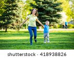 happy mother and adorable... | Shutterstock . vector #418938826