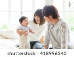 Portrait Of Young Asian Family...