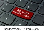 Small photo of Business Concept: Close-up the Accounts Payable Ledger button on the keyboard and have Red color button isolate black keyboard