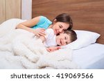 mom and son playing on the bed. | Shutterstock . vector #419069566
