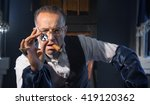 the man   a jeweler examines... | Shutterstock . vector #419120362
