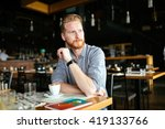 serious man drinking coffee in... | Shutterstock . vector #419133766