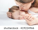 mother kissing a baby. care... | Shutterstock . vector #419224966