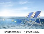 Blue Sea Water And Empty Chair...