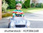 little preschool boy driving... | Shutterstock . vector #419386168