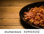 bacon bits on black dish in... | Shutterstock . vector #419414152