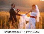 bride looks over her shoulder... | Shutterstock . vector #419448652