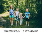 Small photo of Four amicable children: One girl and three boys holding hands