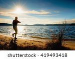 man athlete checking time... | Shutterstock . vector #419493418