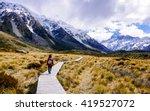 women walking through golden... | Shutterstock . vector #419527072