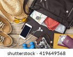 holiday suitcase on wooden table | Shutterstock . vector #419649568