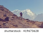 hiker in himalayas mountain.... | Shutterstock . vector #419673628