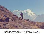 hiker in himalayas mountain.... | Shutterstock . vector #419673628