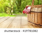 Red napkin picnic basket and...