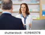 woman pharmacist helping a male ... | Shutterstock . vector #419840578