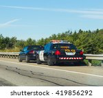 Small photo of CANADA - 29TH AUGUST 2014: A car that has been pulled over by the police on a road in Canada.