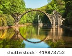 Small photo of Rakotzbrucke also known as Devilâ??s Bridge in Kromlau in Germany. Reflection of the bridge in the water create a full circle.