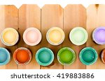 Opened Pots Of Colorful Wood...