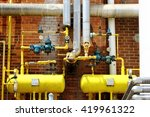 Small photo of ammonia refrigeration piping and tanks