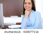 young business woman sitting... | Shutterstock . vector #420077116