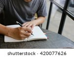 Small photo of man hand write pen on blank notebook ,hand writing pen on paper page,hardworking for achievement business target concept, write idea