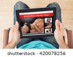 Small photo of High Angle View Of Man Watching Adult Movie On Digital Tablet