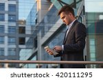 businessman holding a tablet... | Shutterstock . vector #420111295