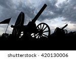Small photo of Cannon silhouettes in the late evening.