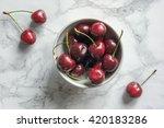 Ripe Cherries In Bowl On Marbl...