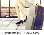 travel time and woman legs  | Shutterstock . vector #420185398