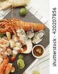 Small photo of Seafood dish of lobster, prawns, squid, mussels and Alaska King Crab
