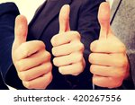 three business people showing... | Shutterstock . vector #420267556