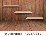 three brown shelves on wooden...   Shutterstock . vector #420377362