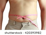 fat man holding a measuring...   Shutterstock . vector #420393982